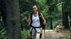 Portrait of young woman hiking in the mountains Stock Footage