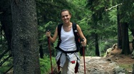 Stock Video Footage of Portrait of young woman hiking in the mountains