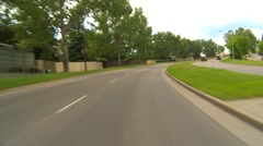 Drive plate, residential street #2, cloudy summer Stock Footage