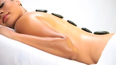 Stock Video Footage of Ethnic Girl Relaxing with Hot Stone Spa Therapy