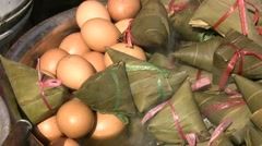 Boiled eggs and rice dumplings, typical street food in China Stock Footage