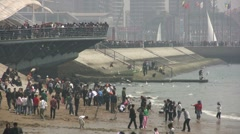 Crowded Chinese beach and promenade at May 1 Holidays Stock Footage