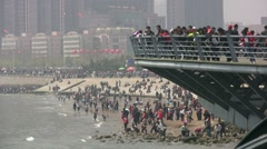 China, people spend time at the beach and promenade Stock Footage