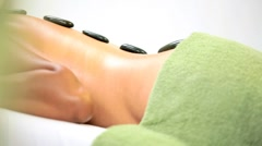 Young Ethnic Female Receiving Hot Stone Therapy Stock Footage