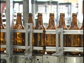 Stock Video Footage of Beer Bottle Manufacturing Machine Line at Brewery