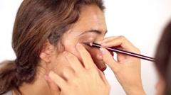 Beautiful model face makeup shooting Stock Footage