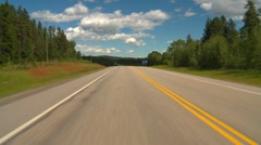 Drive plate, forested hilly rural, light traffic, mostly sunny, #8 Stock Footage