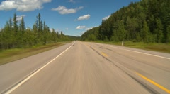 Drive plate, forested hilly rural light traffic in distance, mostly sunny, #3 Stock Footage