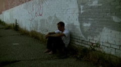 Grungy kid in the ghetto dark and lonely charity work Stock Footage