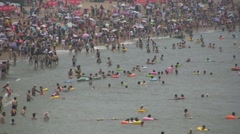 Beach life leisure crowded sea busy people China Chinese Stock Footage
