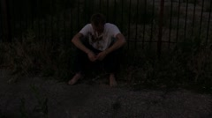 Kid dark and lonely in a scary alley of drunk bums Stock Footage