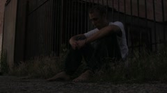 Lonely kid in the streets of the ghetto beat up - stock footage