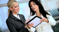 Stock Video Footage of Smart Businesswomen with Wireless Tablet