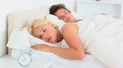 Sleeping couple not wanting to wake up Stock Footage