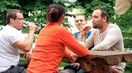Stock Video Footage of Four friends drinking beer, outdoors