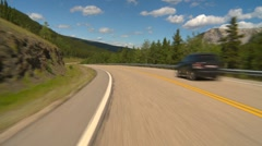 Drive plate, forested hilly rural light traffic in distance, mostly sunny, #5 Stock Footage