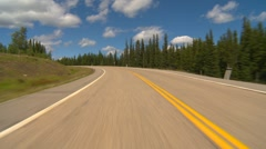 drive plate, forested hilly rural light traffic in distance, mostly sunny, #6 - stock footage