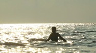 Girl Walking into the Sea at Sunset Stock Footage