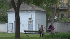 A grandmother with his nephew in park Stock Footage