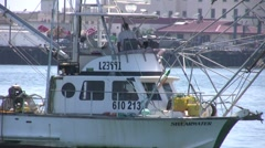 Fishing Boat Backs Away From Pier Stock Footage