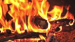 Fireplace full of fire and wood - stock footage