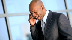 African American Businessman Receiving Good News by Smartphone Stock Footage