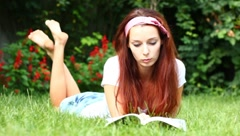 Dreamy young girl with a book Stock Footage