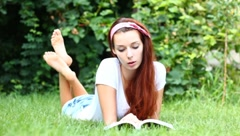 Dreamy reader - stock footage