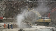 China construction site excavators building drilling pit machinery dust Stock Footage