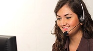 Stock Video Footage of Customer Service worker helping out on phone