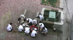 Chinese cooks are preparing ingredients for meals, outside restaurant Stock Footage