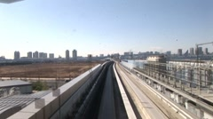 Monorail inbound for Tokyo time-lapse Stock Footage