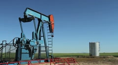 Crude oil pumpjack with tank Stock Footage