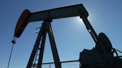 Crude oil pumpjack with sun Stock Footage