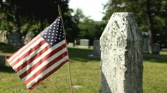 American flag in graveyard - stock footage