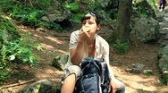 Stock Video Footage of Female hiker resting and eating apple HD