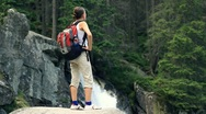 Stock Video Footage of Woman in the forest looking at beautiful waterfall HD