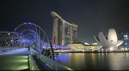 Marina Bay Sands hotel and Helix Bridge Singapore Stock Footage