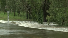 Flash Flood Cuts Off Road During Storm Stock Footage