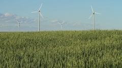Wind turbines with summer wheatfield Stock Footage