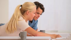 Woman showing her husband a plan Stock Footage
