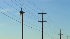 Wind turbines with powerlines - stock footage