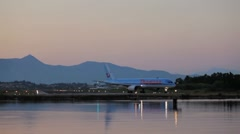 Driving of Thomson airplane before take-off, sunset scene, Corfu airport, Greece Stock Footage