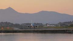 Driving of airplane, sunset scene, Corfu airport, Greece Stock Footage