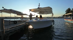 Young pair in the Boat during sunset, Corfu, Greece Stock Footage