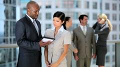Team Leader Preparing Colleagues for Meeting - stock footage