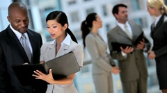 Young Business Executives with Work Portfolios Stock Footage