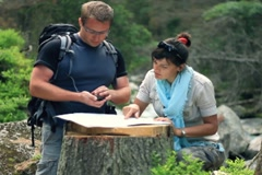 Stock Video Footage of A couple with map and compass in the forest