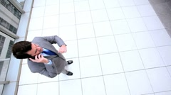 Male Business Executive Using Smartphone Stock Footage