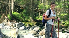 Portrait of young beautiful hiker in the forest Stock Footage